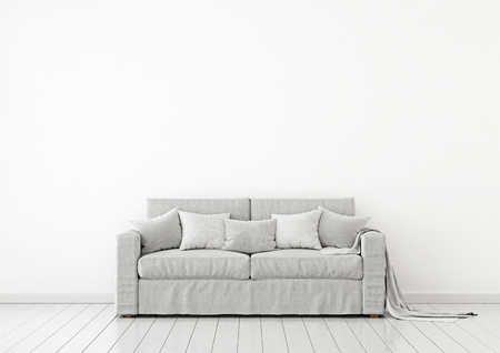 Simple and neutral interior wall mock up with a gray fabric sofa, pillows and plaid on clear white background. 3D rendering.