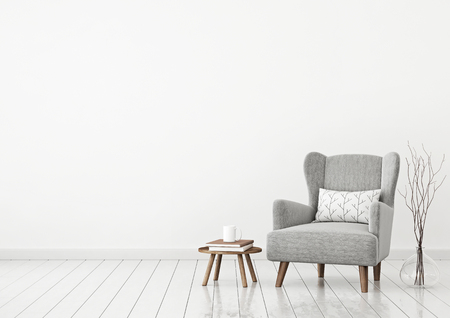 Simple and cozy scandinavian style living room with gray armchair, pillow, books, cup and twigs in vase on clear white wall background. 3D rendering.