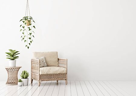 Home interior mock up with wicker rattan armchair, beige pillows and green plants in living room with empty white wall. 3D rendering. Stock Photo