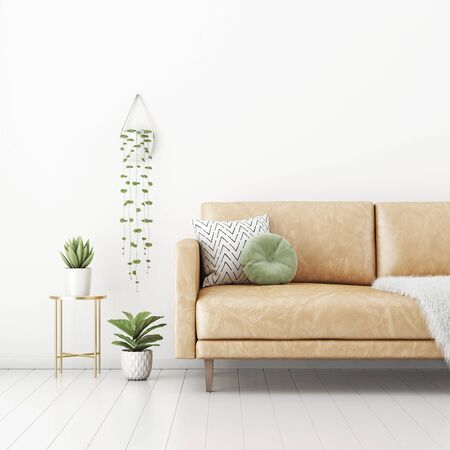 Living room interior wall mockup with tan brown leather sofa, round green pillow, furry plaid and hanging plant on empty white wall background. 3D rendering, illustration.