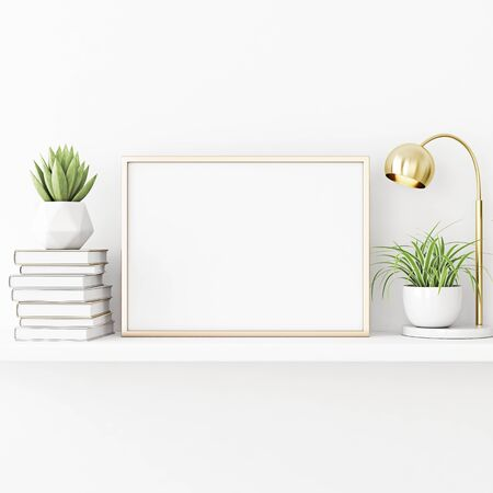 Interior poster mockup with horizontal gold metal frame standing on the table with plants in pots, lamp and pile of books on empty white wall background. 3D rendering, illustration. 스톡 콘텐츠