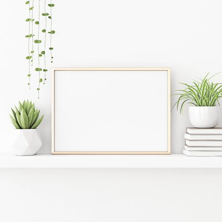 Interior poster mockup with horizontal gold metal frame standing on the table with plants in pots and pile of books on empty white wall background. 3D rendering, illustration. 스톡 콘텐츠