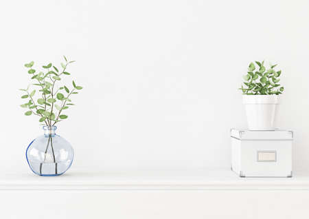 Interior wall mockup with branches in blue vase, box and green plant in pot on empty white background. 3D rendering, illustration. 스톡 콘텐츠