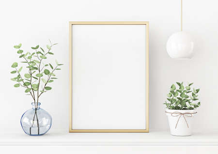 Interior poster mockup with vertical gold metal frame on the table with plants in blue vase and hanging lighting on empty white wall background. A4, A3 size format. 3D rendering, illustration.
