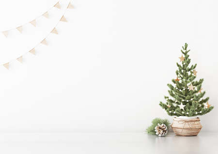 Interior white wall mock up with decorated christmas tree in basket, flag garland and pine cone on empty background. 3D rendering.