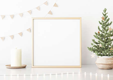 Square poster mock up with golden frame, decorated christmas tree, garland lights and holiday decoration on white wall background. 3D rendering.