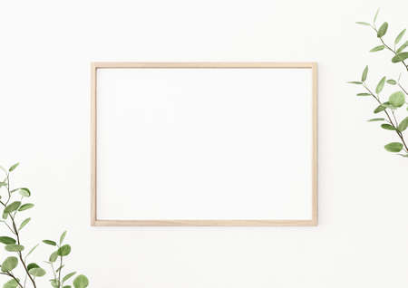 Interior poster mockup with horizontal wooden frame on empty white wall, decorated with plant branches with green leaves. A4, A3 size format. 3D rendering, illustration.