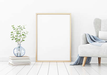 Poster mockup with vertical frame standing on floor in living room interior with armchair and branches in blue vase on empty white wall background. 3D rendering, illustration.