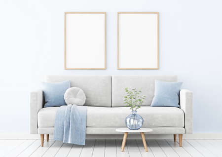 Poster mockup with two vertical wooden frames hanging on the wall in living room interior with sofa, blue pillows and branches in vase on empty background. 3D rendering, illustration. Imagens