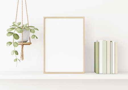 Interior poster mockup with vertical wooden frame on the shelf with green plant in hanging pot, books and trendy decoration on empty white wall background. A4, A3 size. 3D rendering, illustration. Imagens