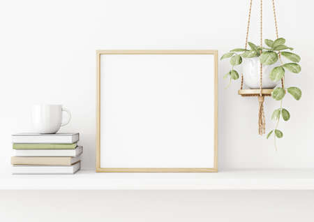 Interior poster mockup with square wooden frame on the shelf with green plant in hanging pot, books, cup and trendy decoration on empty white wall background. 3D rendering, illustration. Imagens