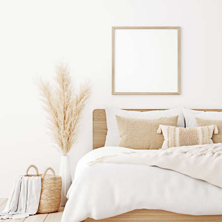 Square frame mockup in boho bedroom interior with wooden bed, beige blanket, pillow with tassels, dried pampas grass and basket on white wall background. 3d rendering, 3d illustration