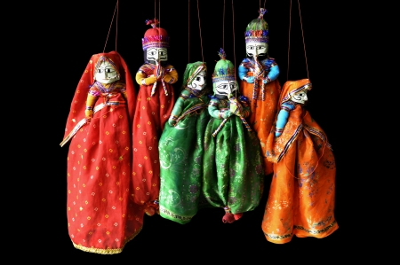 male and female puppets in indian costumes with musical instruments