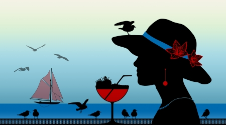 profile of a young woman drinking a strawberry cocktail with a seagull on her hat looking on the sunset above the sea