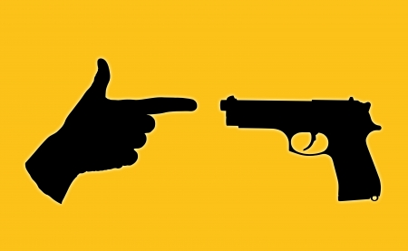 unequal: symbol of an unequal battle between a true gun and a human hand with fingers set in a pistol