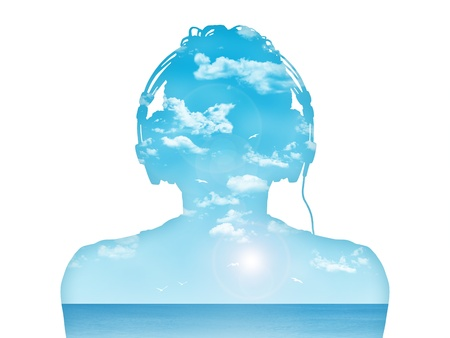 silhouette of a man in headphones listening to the music, nice blue sea landcape inside him