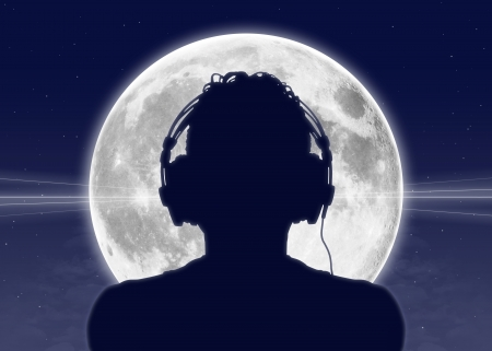listening to people: silhouette of a man in headphones listening to the music with the full moon on the background