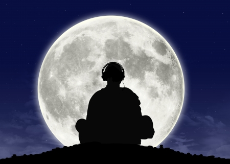 philosophy of music: silhouette of a buddhist monk in headphones in meditation posture with the full moon on the background
