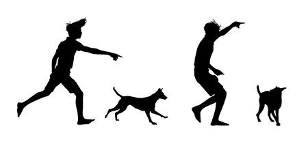 小さな男の子が演奏と彼の犬の訓練の 2 つのシルエットのセット 写真素材