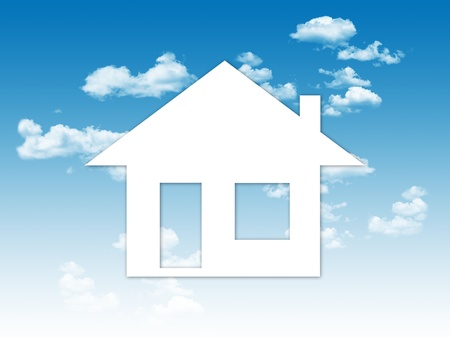little house made of paper flying in the clouds, a dream about having a house Stock Photo