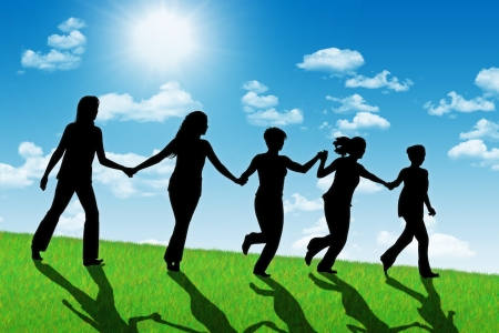 silhouettes of five happy women running down the hill holding their hands with a shining sun on the background