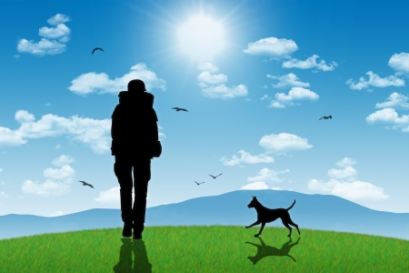 silhouette of a lonely backpacker with his dog walking on a top of a green hill with mountains landscape background photo