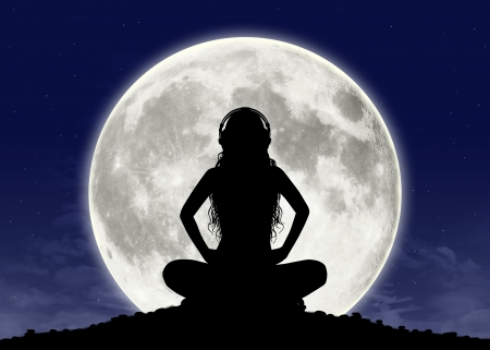 buddhist meditation: silhouette of a young beautiful woman with long hair in headphones in meditation posture with the full moon on the background