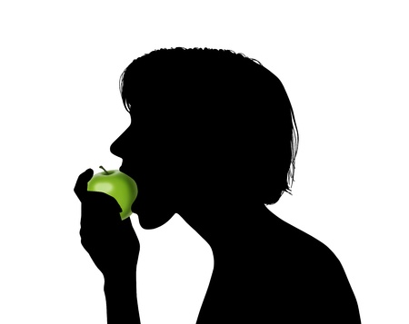 profile of a young woman biting a green apple