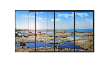isolated panoramic 4 parts sliding modern aluminum window  with stones and little lakes  photo