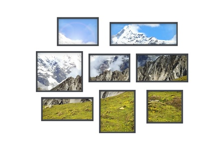 composition of several isolated windows of different size on a white wall with a view on beautiful mountains photo