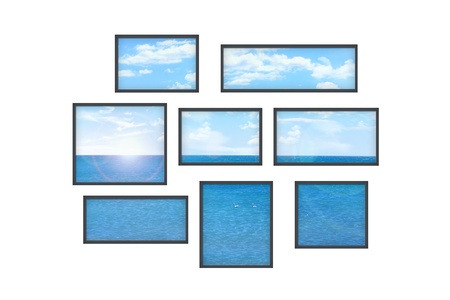 composition of several isolated windows of different size on a white wall with a view on a sea landscape photo