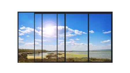 isolated panoramic 4 parts sliding modern aluminum window  with a lake landscape