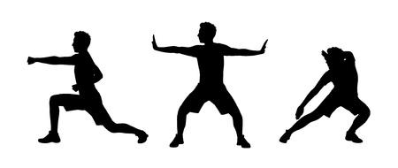 若い男が太極拳シルエットの練習