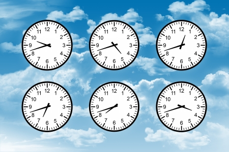 six clocks with different time on them on a blue sky background Stock Photo