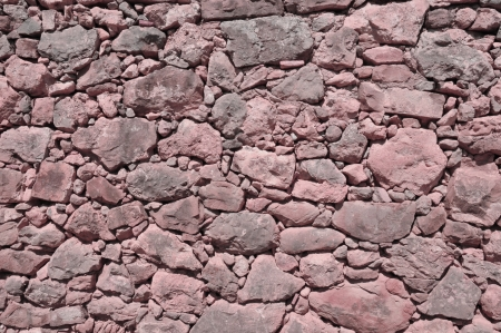 impure: vinous old wall made of big and little rough stones without cement Stock Photo