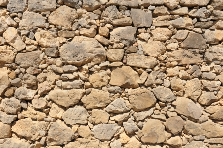 impure: yellow old wall made of big and little rough stones without cement