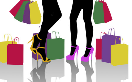 two young beautiful women standing in front of each other with lots of colorful shopping bags around them, zoom on their legs photo
