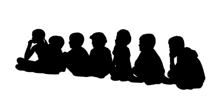 side viewing: black silhouette of a large group of children of same age seated on the floor in a row, profile view Stock Photo
