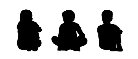 black silhouettes of three little boys age 5-10 seated on the floor face to the onlooker in different postures photo