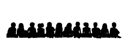 about age: black silhouettes of large group of twelve children about age 5-10 seated in a row on the floor face to the onlooker in different postures