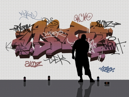 young man drawing tags on the white brick wall with graffiti