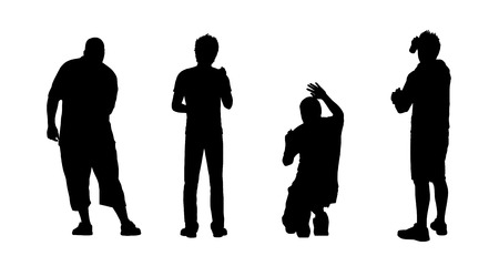 tagging: silhouettes of four young men drawing graffiti on the wall in different postures, view from behind Stock Photo