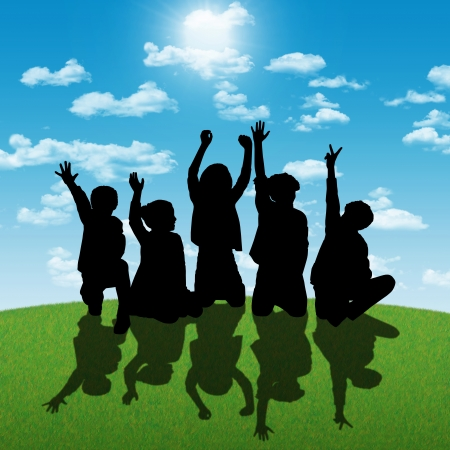 about age: silhouettes of five children about age 7-10 seated in a row on the grass back to the shining sun, their hands are in the air