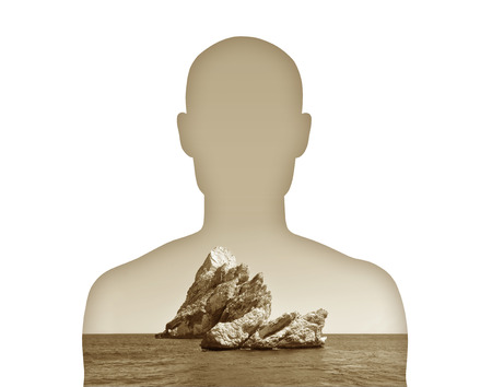 heaviness: silhouette of a young man s portrait showing a huge stone on his heart Stock Photo