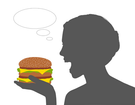 open sandwich: young beautiful woman holding a huge cheeseburger in her hand about to eat it all, a vacant text bubble next to her Stock Photo