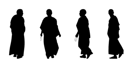 silhouettes of buddhist monks and nuns in traditional clothes walking Stock Photo