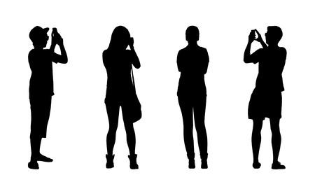 普通の 10 代の女の子と別のポーズ、前面および背面ビューで屋外に立っている男の子のシルエット 写真素材