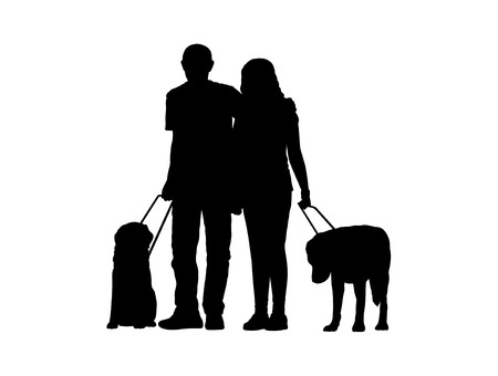 silhouette of a couple of blind people standing together with their dogs photo