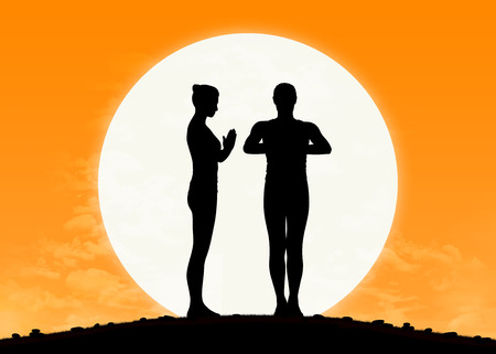 silhouette of a young man and woman practicing yoga together with the rising sun on the background
