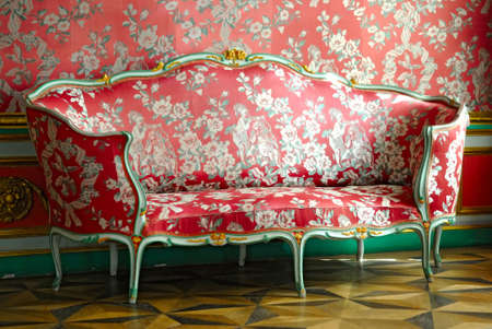 old furniture: red sofa in old mansion